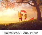 two happy funny children under... | Shutterstock . vector #700214392