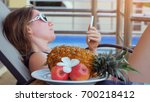 young woman wearing sunglasses... | Shutterstock . vector #700218412