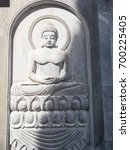 carving of a buddha of the... | Shutterstock . vector #700225405