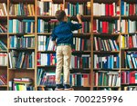back view  boy on a chair... | Shutterstock . vector #700225996