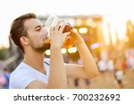 man drinking beer | Shutterstock . vector #700232692