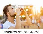 man drinking beer | Shutterstock . vector #700232692