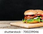 a delicious homemade burger... | Shutterstock . vector #700239046