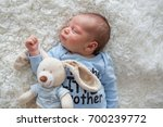 little newborn baby sleeping... | Shutterstock . vector #700239772