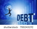 businessman avoiding debt... | Shutterstock . vector #700243192