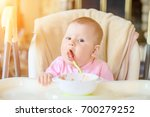 a cheerful happy child eats... | Shutterstock . vector #700279252