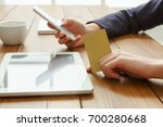 woman using phone for online... | Shutterstock . vector #700280668