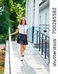 a girl in school uniform on a... | Shutterstock . vector #700285582