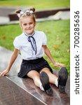 a girl in school uniform on a... | Shutterstock . vector #700285636