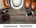 smartphone  brown shoes ... | Shutterstock . vector #700290352