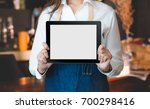 close up on blank tablet... | Shutterstock . vector #700298416
