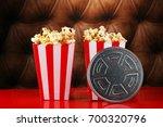 popcorn in a striped box. movie ... | Shutterstock . vector #700320796