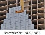facade of a skyscraper... | Shutterstock . vector #700327048