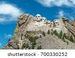 close up of the granite heads... | Shutterstock . vector #700330252