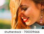 beautiful woman with long hair... | Shutterstock . vector #700339666