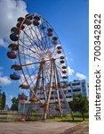 Small photo of Old rusty abandoned Ferris wheel in the amusement park in Ochamchira, Abkhazia, Georgia