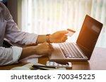 man hand touching laptop for...   Shutterstock . vector #700345225
