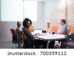 group of a young business... | Shutterstock . vector #700359112