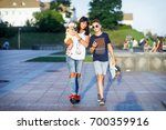 a mother with two children is... | Shutterstock . vector #700359916