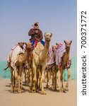 bedouin men riding the camels... | Shutterstock . vector #700371772