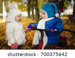 boy and girl in autumn park | Shutterstock . vector #700375642