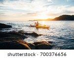 kayaker paddling the kayak at... | Shutterstock . vector #700376656