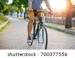 summer cycling through the park.... | Shutterstock . vector #700377556