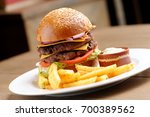 hamburger with french fries and ... | Shutterstock . vector #700389562