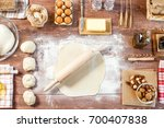 rolled out dough on wooden... | Shutterstock . vector #700407838