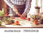 male cooking healthy salad | Shutterstock . vector #700410418