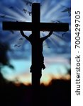 Small photo of Jesus Christ cross silhouette over sunset sky with rays and flying doves