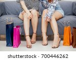 woman legs sitting near... | Shutterstock . vector #700446262