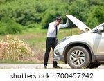 full length of a worried... | Shutterstock . vector #700457242