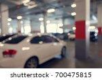 abstract blur car parking lot... | Shutterstock . vector #700475815