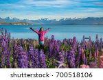 woman traveller at lake tekapo  ... | Shutterstock . vector #700518106