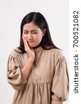 Small photo of painful woman with toothache, tooth decay, sensitivity