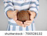 young woman with coconut on... | Shutterstock . vector #700528132