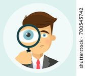 business man with magnifying...   Shutterstock .eps vector #700545742