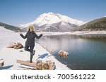 young woman on nature joking... | Shutterstock . vector #700561222