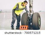 Stock photo airport worker mechanic 700571215