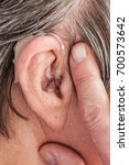 Small photo of Closeup senior woman with hearing aid in her ear. Health care, hear amplify, device for the deaf.