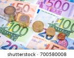 banknotes and euro coins | Shutterstock . vector #700580008