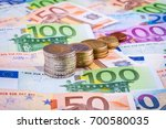 banknotes and euro coins | Shutterstock . vector #700580035