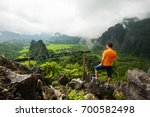 hiking man stand on top... | Shutterstock . vector #700582498