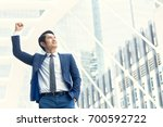 smiling young businessman... | Shutterstock . vector #700592722