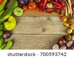 vegetables on a wooden board.... | Shutterstock . vector #700593742