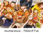 people eat healthy meals at... | Shutterstock . vector #700619716