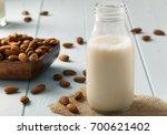 Almond Milk In Glass Bottle An...