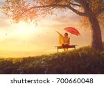 happy funny child with red... | Shutterstock . vector #700660048