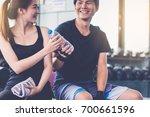 fitness man giving bottle of... | Shutterstock . vector #700661596